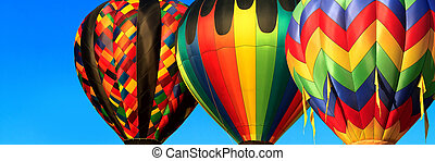 hot air balloons - panorama of colorful hot air balloons