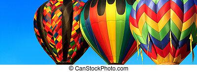 hot air balloons - panorama of colorful hot air balloons