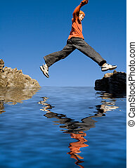 fit healthy active kid jumping rocks on vacation