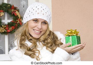 woman holding wrapped gift or present