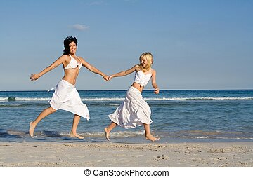happy family, mother and daughter running on beach on summer vacation holiday