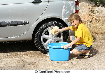 child washing car helping doing chores