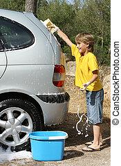 kid playing having fun cleaning or washing car