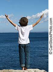 child arms raised in joy and happiness