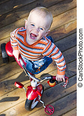 Boy on tricycle - Boy on red tricycle