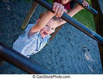 Monkey bars - Boy swinging on monkey bars