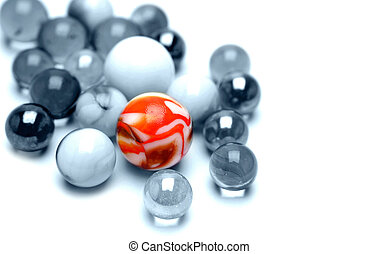 Marbles - One bright marble standing out from the crowd