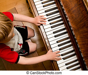 Learning piano - Boy learning to play piano