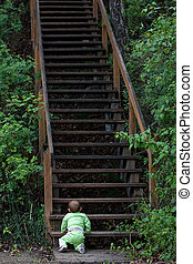 Uphill battle - Baby at bottom of long staircase
