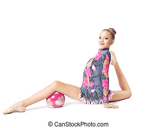 young girl doing split with ball isolated