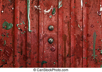 Bolt heads on stained red work meta - Metal slate used for...
