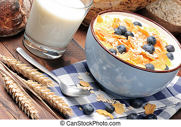 Healthy breakfast with cereals and blueberries on the wooden...