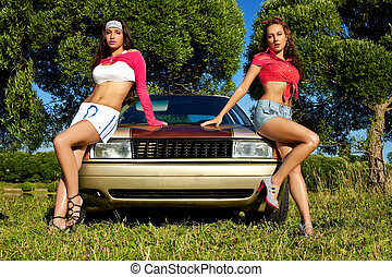 two young sexy girl ready for car washing at summer sunset
