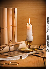 antic candle with rool of paper