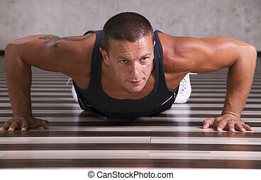 Push ups - Fitness instructor exercising