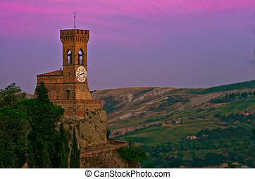 Old clock tower on the mountains shot as dusk
