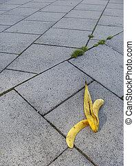 slide banana peel on pavement risk theme