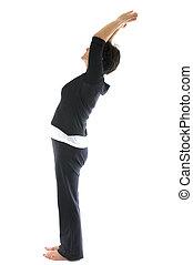 middle age senior woman mountain tadasana yoga back stretch posi