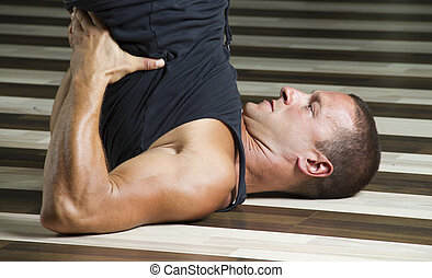 Streching in the gym while workingout