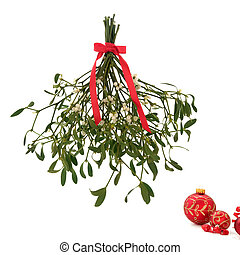 Mistletoe - Mistletoe with berries and tied with a red bow...