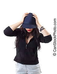 young woman in grunge style with baseball cap