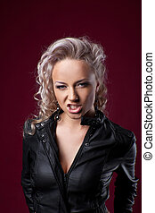 Pretty sexy anger blond woman in leather jacket