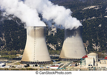 nuclear energy - two smokestacks of nuclear industry in...