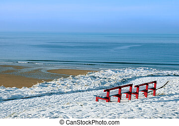atlantic winter view and red benches