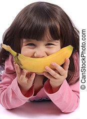 Little girl with banana smile - Young little girl making a...