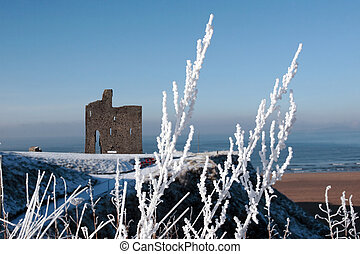 seasonal view of ballybunion castle and beach in snow