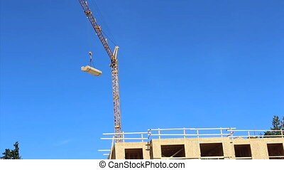 Constuction Crane Pivoting - A construction crane pivots...