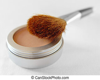 Blush - A facial blush with a brush over white