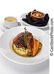Plated Rotisserie Chicken Dinner - Rotisserie roasted...