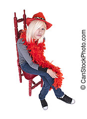 Teenager wearing feather boa and hat