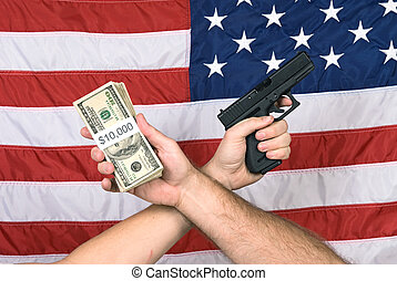 American culture - Cash and a gun held against the American...