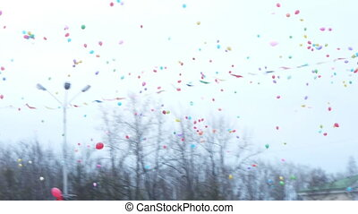 Thousands of balloons flying to the sky