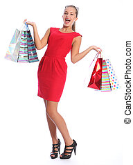 Sexy happy woman in red dress shopping gift bags - Shopping...