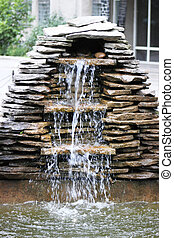 Hot Tub Waterfall - An image of a tiled spa with fountain