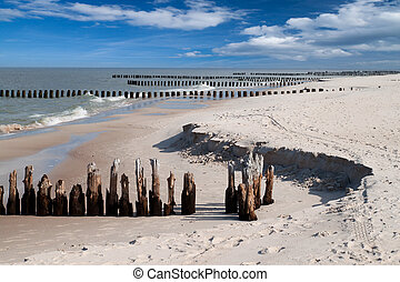 Baltic sea  - Wooden breakwaters at Baltic sea coast.