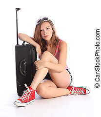 Pretty teenager girl packed waiting with suitcase -...