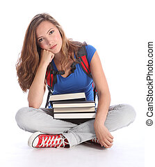 Sad teenage student girl with school study books - Study...