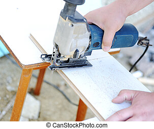 planing a piece of wood trim for a project