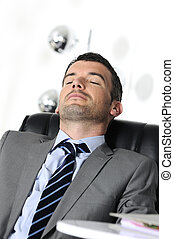 taking break - Attractive businessman is sleeping a while...
