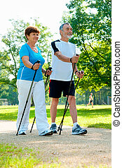 Nordic Walking - Senior couple nordic walking