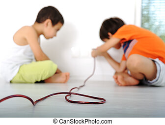 Dangerous game, children experimenting with electricity
