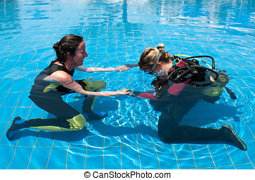 Learning to scuba dive - Scuba diving instructor and student...