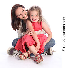 Mother daughter fun and laughter sitting on floor