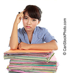 young woman stressed at work with many files