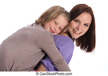 Big smiles mother and daughter piggy back fun