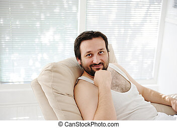 Relaxed man at home